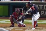 Washington Nationals' Victor Robles hits a single during the third inning of Game 3 of the baseball National League Championship Series against the St. Louis Cardinals Monday, Oct. 14, 2019, in Washington. (AP Photo/Alex Brandon)