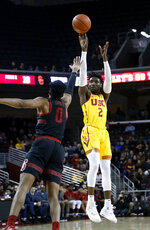 Southern California's Jonah Mathews, right, shoots against KZ Okpala during the first half of an NCAA college basketball game Sunday, Jan. 6, 2019, in Los Angeles. (AP Photo/Ringo H.W. Chiu)