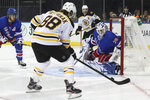 New York Rangers goaltender Henrik Lundqvist (30) tends net against Boston Bruins right wing David Pastrnak (88) during the first period of an NHL hockey game, Sunday, Oct. 27, 2019, at Madison Square Garden in New York. (AP Photo/Mary Altaffer)