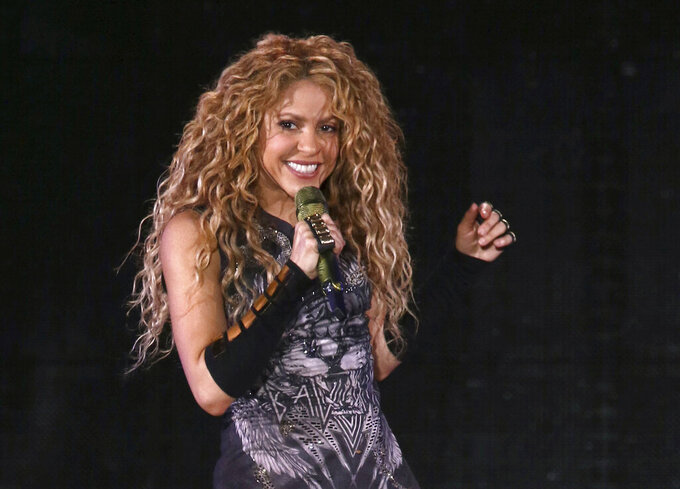 FILE - This Aug. 10, 2018 file photo shows Shakira performing in concert at Madison Square Garden in New York.   A Spanish judge investigating alleged tax fraud by Colombian musician Shakira has recommended Thursday July 29, 2021, for the case to go to trial after concluding there is evidence that the pop star could have avoided her fiscal obligations to the state. (Photo by Greg Allen/Invision/AP, File)