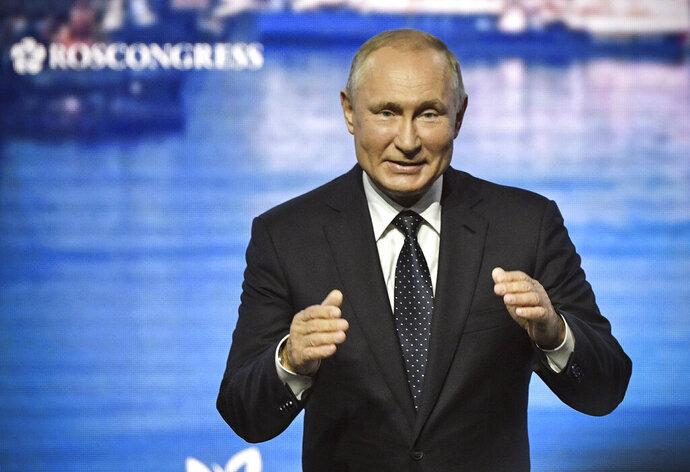 Russian President Vladimir Putin opens a plenary session of the Eastern Economic Forum in Vladivostok, Russia, Thursday, Sept. 5, 2019. Vladivostok hosts the Eastern Economic Forum on September 4-6. (Alexander Nemenov/Pool Photo via AP)