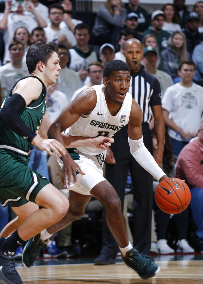 Michigan State's Aaron Henry, right, drives as Binghamton's Yarden Willis defends during the first half of an NCAA college basketball game Sunday, Nov. 10, 2019, in East Lansing, Mich. (AP Photo/Al Goldis)