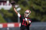San Francisco 49ers quarterback Jimmy Garoppolo throws a pass at NFL football training camp in Santa Clara, Calif., Wednesday, July 28, 2021. (AP Photo/Jeff Chiu)