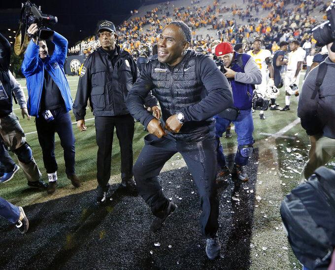 Vanderbilt head coach Derek Mason dances on the field after defeating Tennessee in an NCAA college football game Saturday, Nov. 24, 2018, in Nashville, Tenn. (AP Photo/Mark Humphrey)