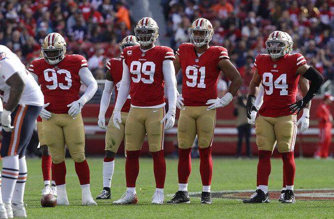 FILE - In this Dec. 23, 2018, file photo, San Francisco 49ers defensive tackle D.J. Jones (93), defensive end DeForest Buckner (99), defensive end Arik Armstead (91) and defensive end Solomon Thomas (94) wait at the line of scrimmage during the first half of the team's NFL football game against the Chicago Bears in Santa Clara, Calif. The 49ers traded Buckner and are looking to fill holes in the defensive line in the upcoming draft. (AP Photo/Jeff Chiu, File)