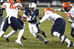 Penn State running back Keyvone Lee (24) looks to elude Illinois defensive lineman Jer'Zhan Newton (94) during the first quarter of an NCAA college football game in State College, Pa., on Saturday, Dec. 19, 2020. (AP Photo/Barry Reeger)
