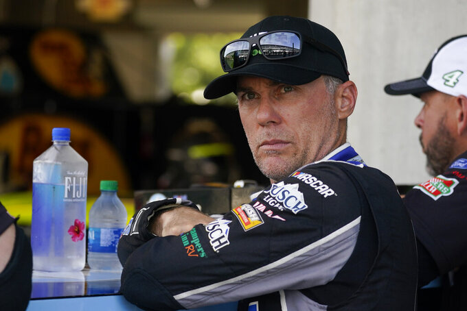 Kevin Harvick waits in his garage before practice for a NASCAR Cup Series auto race at Indianapolis Motor Speedway, Saturday, Aug. 14, 2021, in Indianapolis. (AP Photo/Darron Cummings)