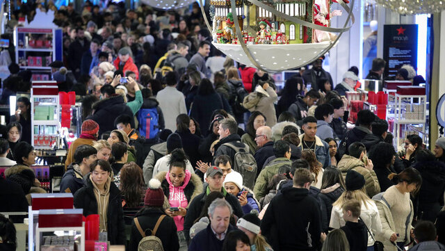 People shop at Macy's department store during Black Friday shopping, Friday Nov. 29, 2019, in New York. Black Friday shoppers fought for parking spots and traveled cross-state to their favorite malls, kicking off a shortened shopping season that intensified the mad scramble between Thanksgiving and Christmas. (AP Photo/Bebeto Matthews)