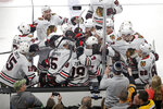 Chicago Blackhawks players mob Jonathan Toews (19) as they celebrate his game-winning goal against the Boston Bruins in the overtime period of an NHL hockey game, Thursday, Dec. 5, 2019, in Boston. The Blackhawks won 4-3 in overtime. (AP Photo/Elise Amendola)