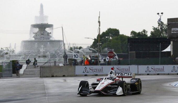 Josef Newgarden takes the 10th turn during the first race of the IndyCar Detroit Grand Prix auto racing doubleheader, Saturday, June 1, 2019, in Detroit. (AP Photo/Carlos Osorio)