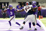 Minnesota Vikings quarterback Jake Browning (3) runs from Denver Broncos defensive tackle Shamar Stephen (99) in the end zone during the first half of an NFL preseason football game, Saturday, Aug. 14, 2021, in Minneapolis. (AP Photo/Jim Mone)