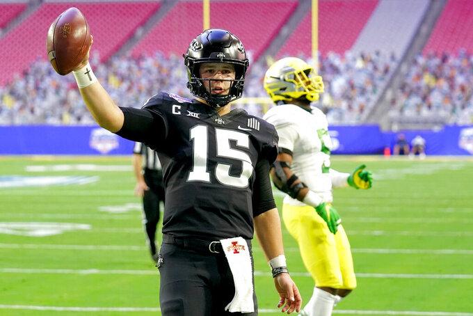 Iowa State quarterback Brock Purdy (15) walks in for a touchdown against Oregon during the first half of the Fiesta Bowl NCAA college football game, Saturday, Jan. 2, 2021, in Glendale, Ariz. (AP Photo/Rick Scuteri)
