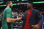 Boston Celtics' Jayson Tatum, left, greets New Orleans Pelicans' Zion Williamson following an NBA basketball game Saturday, Jan. 11, 2020, in Boston. Both played at Duke. (AP Photo/Winslow Townson)