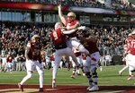 Boston College quarterback Dennis Grosel, top, celebrates his touchdown pass to wide receiver Kobay White (9) in the first half of an NCAA college football game against Florida State, Saturday, Nov. 9, 2019, in Boston. (AP Photo/Bill Sikes)