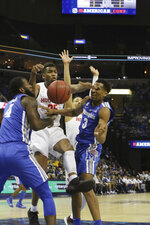 Memphis players Rayne Thornton and Jeremiah Martin are stopped by Houston's Galen Robinson Jr and Prison Gresham in the first half of an NCAA college basketball game at the American Athletic Conference tournament Saturday, March 16, 2019, in Memphis, Tenn. (AP Photo/Troy Glasgow)