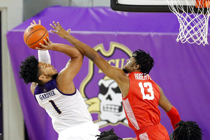 East Carolina's Jayden Gardner (1) draws a foul on Houston's J'Wan Roberts (13) during the first half of an NCAA college basketball game in Greenville, N.C., Wednesday, Feb. 3, 2021. (AP Photo/Karl B DeBlaker)