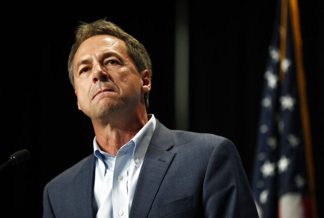 FILE - In this Sunday, June 9, 2019, file photo, Democratic presidential candidate Steve Bullock speaks during the Iowa Democratic Party's Hall of Fame Celebration, in Cedar Rapids, Iowa. Bullock announced Monday, Dec. 2, 2019, that he is ending his Democratic presidential campaign. (AP Photo/Charlie Neibergall, File)