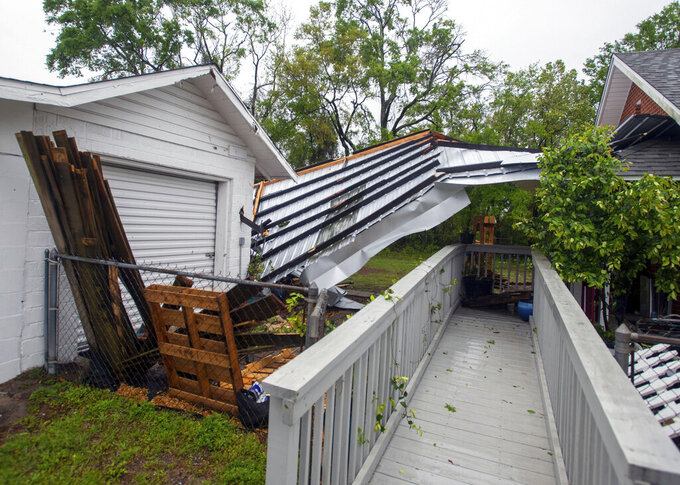 A powerful storm ripped off the roof of Emerald Coast Brewing on West Government Street in Pensacola, Fla., on Saturday, April 10, 2021. Part of the roof landed at the business next door. (John Blackie/Pensacola News Journal via AP)