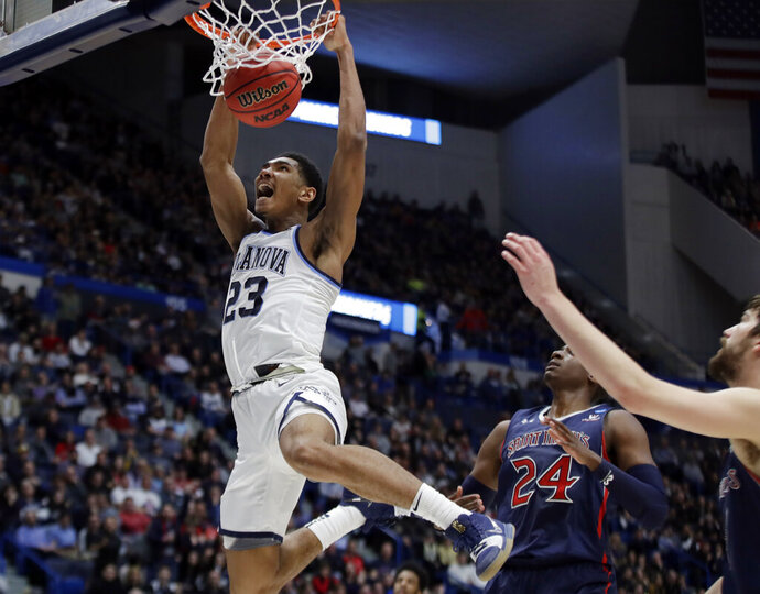 Villanova's Jermaine Samuels (23) dunks against St. Mary's Malik Fitts (24) during the second half of a first round men's college basketball game in the NCAA Tournament, Thursday, March 21, 2019, in Hartford, Conn. (AP Photo/Elise Amendola)