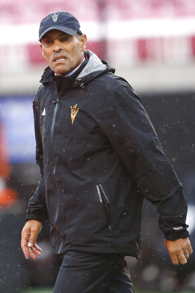 Arizona State head coach Herm Edwards walks on to the field before an NCAA college football game against Utah Saturday, Oct. 19, 2019, in Salt Lake City. (AP Photo/Rick Bowmer)