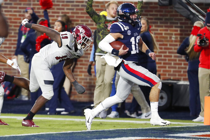Mississippi quarterback John Rhys Plumlee (10) outruns New Mexico State defensive back Austin Perkins (19) on his way to a 18-yard touchdown run during the second half of an NCAA college football game in Oxford, Miss., Saturday, Nov. 9, 2019. (AP Photo/Rogelio V. Solis)