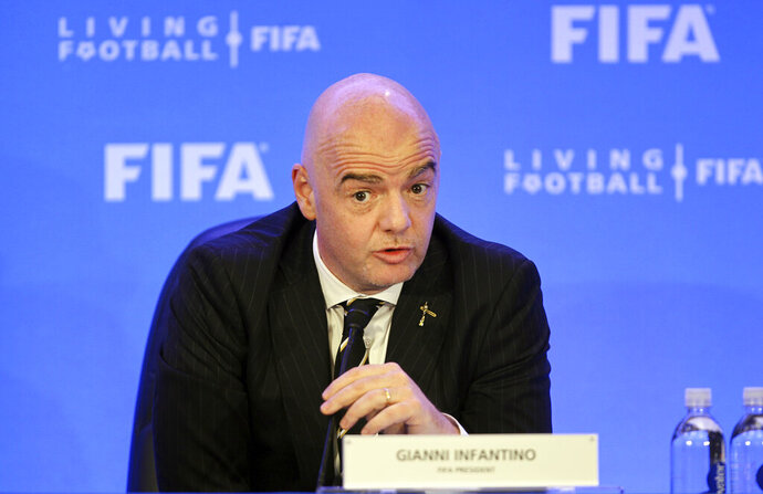 FIFA President Gianni Infantino talks during a press conference after the FIFA Council Meeting, Friday, March 15, 2019, in Miami. The council approved working with Qatar to explore expanding the 2022 World Cup to 48 teams by adding at least one more country in the Persian Gulf to host matches. (AP Photo/Luis M. Alvarez)