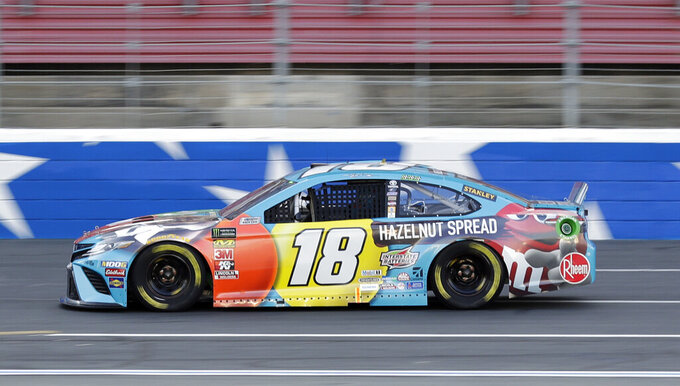 Kyle Busch drives during qualifying for Saturday's NASCAR All-Star auto race at Charlotte Motor Speedway in Concord, N.C., Friday, May 17, 2019. (AP Photo/Chuck Burton)