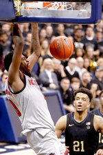 North Carolina State's DJ Funderburk, left, dunks as Pittsburgh's Terrell Brown (21) looks on during the second half of an NCAA college basketball game, Saturday, Feb. 9, 2019, in Pittsburgh. (AP Photo/Keith Srakocic)