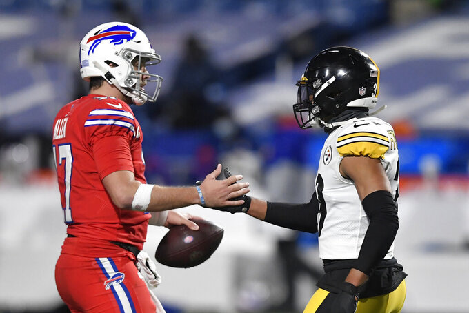 Buffalo Bills quarterback Josh Allen (17) and Pittsburgh Steelers free safety Minkah Fitzpatrick (39) shake hands after an NFL football game in Orchard Park, N.Y., Sunday, Dec. 13, 2020. The Bills won 26-15. (AP Photo/Adrian Kraus)