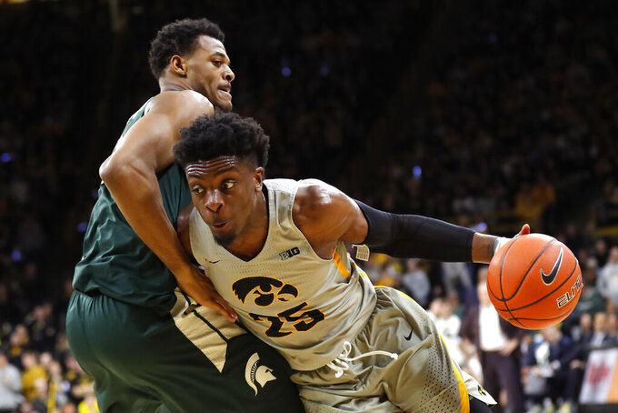 Iowa forward Tyler Cook drives past Michigan State forward Xavier Tillman, left, during the second half of an NCAA college basketball game Thursday, Jan. 24, 2019, in Iowa City, Iowa. (AP Photo/Charlie Neibergall)