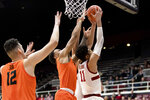 Oregon State guard Sean Miller-Moore, middle, blocks a shot by Stanford forward Jaiden Delaire (11) during the first half of an NCAA college basketball game Thursday, Jan. 30, 2020, in Stanford, Calif. (AP Photo/John Hefti)
