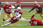 San Francisco 49ers defensive end Kerry Hyder Jr. (92) pulls down Arizona Cardinals quarterback Kyler Murray (1) during the second half of an NFL football game in Santa Clara, Calif., Sunday, Sept. 13, 2020. (AP Photo/Josie Lepe)