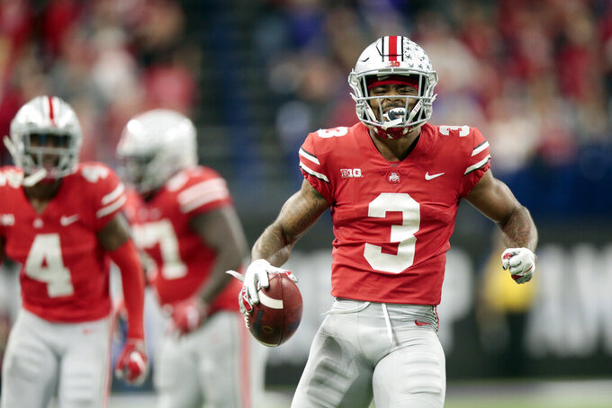 FILE - In this Dec. 1, 2018, file photo, Ohio State cornerback Damon Arnette (3) celebrates after an interception during the second half of the Big Ten championship NCAA college football game against Northwestern in Indianapolis. The Las Vegas Raiders selected Arnette with the 19th pick in the first round of the NFL draft Thursday, April 23. (AP Photo/AJ Mast, File)