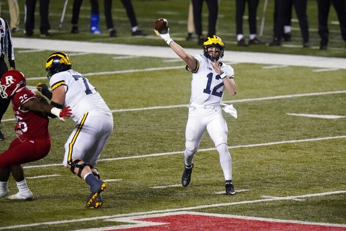 Michigan's Cade McNamara throws a pass during the second half of the team's NCAA college football game against Rutgers on Saturday, Nov. 21, 2020, in Piscataway, N.J. Michigan won 48-42. (AP Photo/Frank Franklin II)