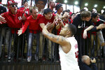 Rutgers guard Jacob Young celebrates with fans after Rutgers defeated Penn State in an NCAA college basketball game Tuesday, Jan. 7, 2020, in Piscataway, N.J. Rutgers won 72-61. (AP Photo/Michael Owens)