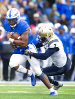 Air Force quarterback Donald Hammond III (5) is brought down by Navy cornerback Khaylan Williams (7) during an NCAA college football game at Falcon Stadium at the U.S. Air Force Academy, Saturday Oct. 6, 2018, in Colorado Springs, Colo.  (Dougal Brownlie,/The Gazette via AP)