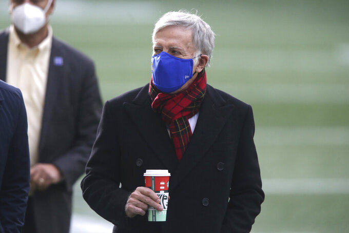 Los Angeles Rams owner Stan Kroenke walks on the field before an NFL football game against the Seattle Seahawks, Sunday, Dec. 27, 2020, in Seattle. (AP Photo/Scott Eklund)