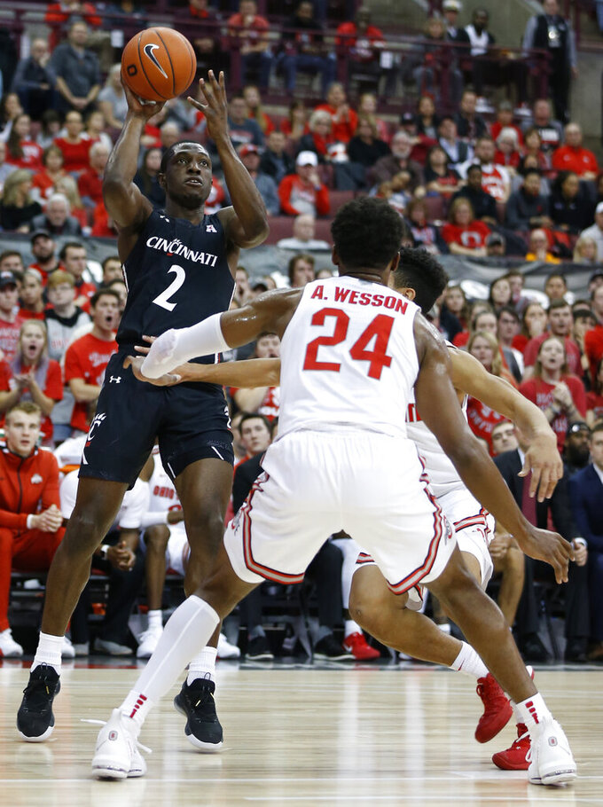 Cincinnati's Keith Williams (2) shoots over Ohio State's Andre Wesson (24) during the first half of an NCAA college basketball game Wednesday, Nov. 6, 2019, in Columbus, Ohio. (AP Photo/Jay LaPrete)