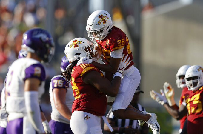 Iowa State defensive end Eyioma Uwazurike (58) celebrates knocking down a pass with defensive back Anthony Johnson Jr. (26) during the second half of an NCAA college football game against Northern Iowa, Saturday, Sept. 4, 2021, in Ames, Iowa. Iowa State won 16-10. (AP Photo/Matthew Putney)