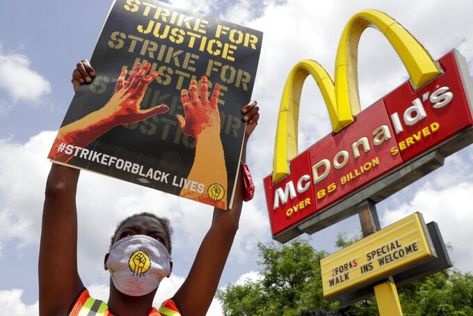 Strike for justice protesters rally outside a McDonald's Monday, July 20, 2020, in Milwaukee. Thousands across the country walked off the job to protest systemic racism and economic inequality that has worsened during the coronavirus pandemic. (AP Photo/Morry Gash)