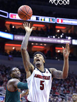 Louisville center Malik Williams (5) attempts a shot away from the defense of Miami center Ebuka Izundu (15) during the second half of an NCAA college basketball game in Louisville, Ky., Sunday, Jan. 6, 2019. Louisville won 90-73. (AP Photo/Timothy D. Easley)