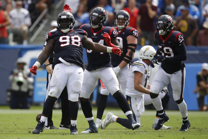 Houston Texans defensive end D.J. Reader celebrates after sacking Los Angeles Chargers quarterback Philip Rivers during the first half of an NFL football game Sunday, Sept. 22, 2019, in Carson, Calif. (AP Photo/Marcio Jose Sanchez)
