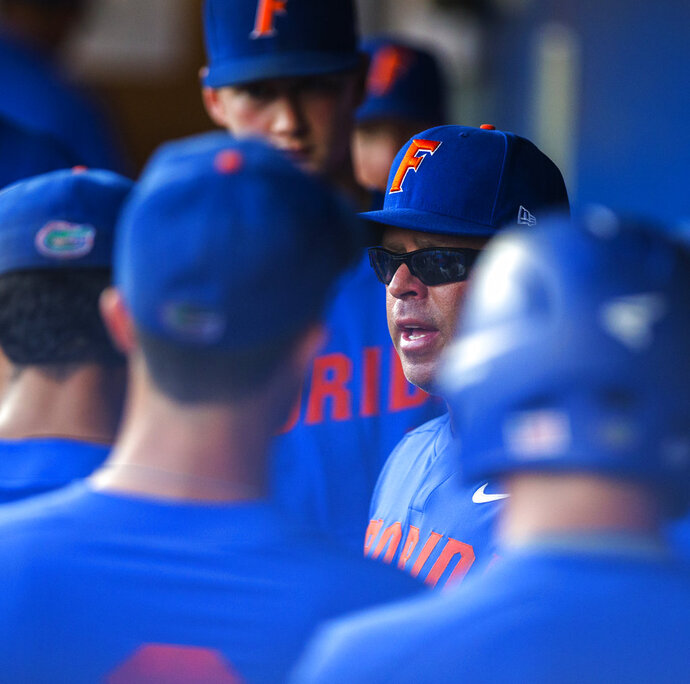 Florida head coach Kevin O' Sullivan talks to his players in the dugout in Game 1 of the NCAA Regionals baseball final against FAU, Monday, June 4, 2018, at McKethan Stadium in Gainesville, Fla. (Cyndi Chambers/The Gainesville Sun via AP)