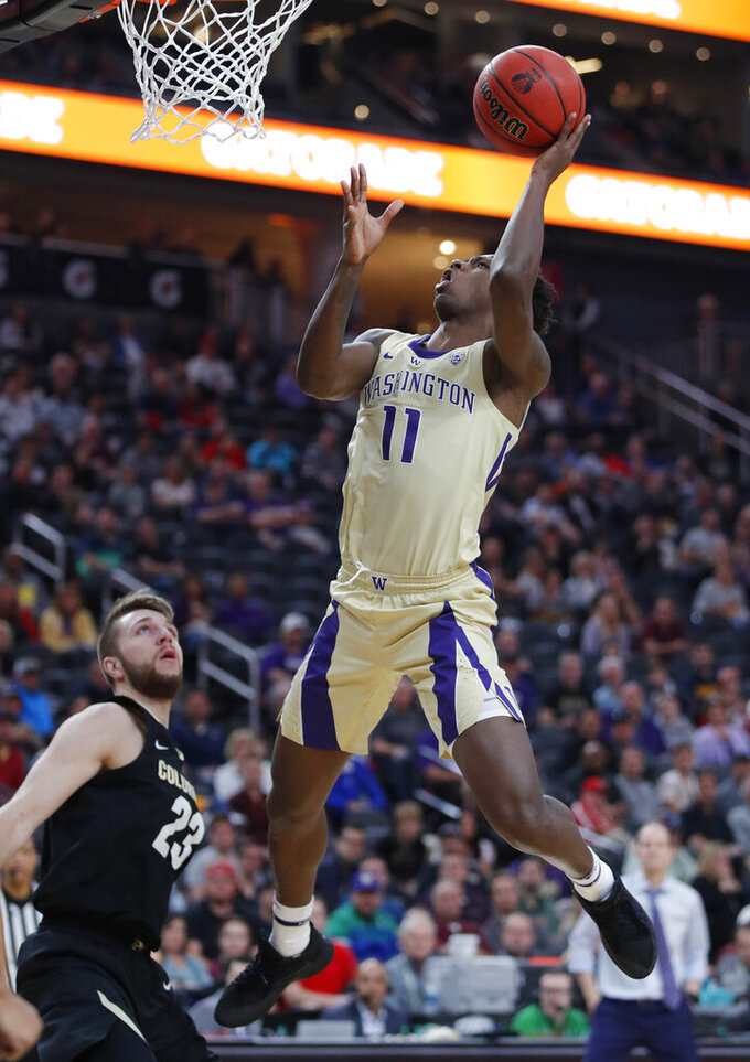 Washington's Nahziah Carter shoots over Colorado's Lucas Siewert during the second half of an NCAA college basketball game in the semifinals of the Pac-12 men's tournament Friday, March 15, 2019, in Las Vegas. (AP Photo/John Locher)