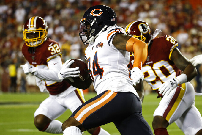 Chicago Bears wide receiver Cordarrelle Patterson (84) runs with ball as he is pursued by Washington Redskins cornerback Jimmy Moreland (32) and safety Landon Collins (20) during the first half of an NFL football game Monday, Sept. 23, 2019, in Landover, Md. (AP Photo/Patrick Semansky)