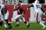 Alabama running back Damien Harris (34) runs into a hole during the first half of an NCAA college football game  against Auburn, Saturday, Nov. 24, 2018, in Tuscaloosa, Ala. (AP Photo/Vasha Hunt)