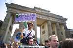 Students hold posters as they attend a protest rally of the 'Friday For Future' movement in Berlin, Germany, Friday, May 24, 2019. Some thousands students attend the demonstration near the Brandenburg gate in the German capital. (AP Photo/Markus Schreiber)