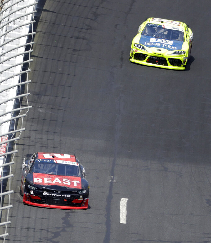 Tyler Reddick (2) leads Brandon Jones (19) out of Turn 4 during the NASCAR Xfinity Series auto race at Charlotte Motor Speedway in Concord, N.C., Saturday, May 25, 2019. (AP Photo/Chuck Burton)