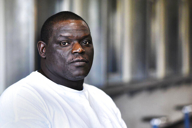 FILE - In this Sept. 2016 file photo, David Robinson poses for a portrait in the visiting area inside Jefferson City Correctional Center in Jefferson City, Mo. The city of Sikeston, Mo. has agreed to an $8 million settlement in a lawsuit filed by Robinson who spent 17 years in prison for murder before the state Supreme Court overturned his conviction. City manager Jonathan Douglas announced the settlement Friday, May 15, 2020, with Robinson, who sued the city after he was released from prison in May 2018 when a judge ruled there was clear evidence that he didn't kill local bar owner Sheila Box in 2000, the Southeast Missourian reported.(Laura Simon/The Southeast Missourian via AP File)
