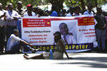 Zimbabwean doctors protest in Harare, Wednesday, Sept, 18, 2019. Zimbabwean doctors protesting the alleged abduction of a union leader were met by a line of baton- wielding police in the capital as fears grow about government repression. (AP Photo/Tsvangirayi Mukwazhi)